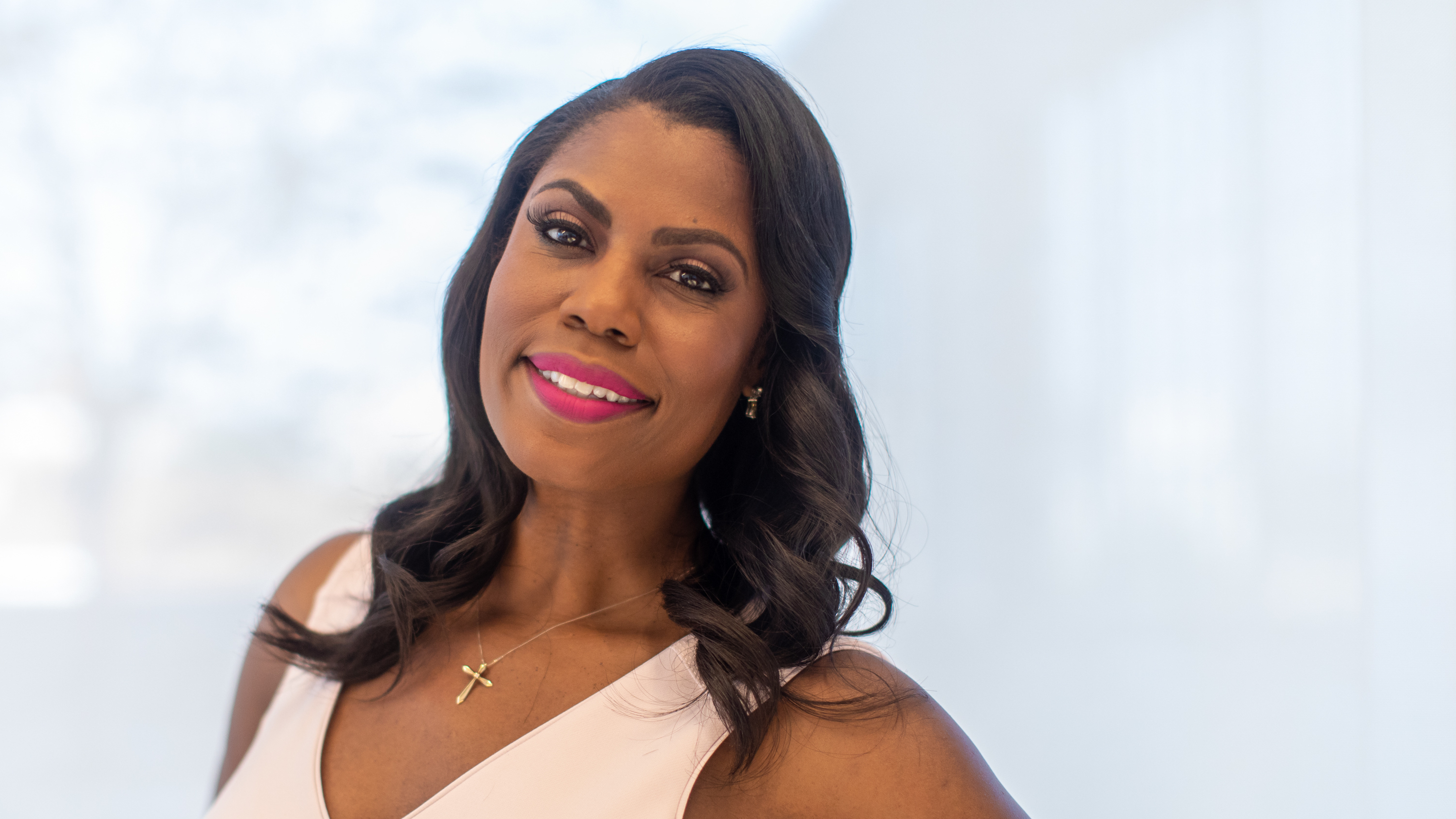 """In her new book """"Unhinged,"""" former White House aide Omarosa Manigault Newman writes as a Trump world insider overjoyed at his election while airing concerns about his rhetoric, policies and mental state."""
