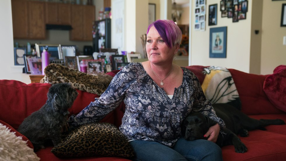 Michel, joined on the couch by longtime pet Blade and service dog Lizzy, says at least three male service members assaulted or molested her between 1990 and 2005.