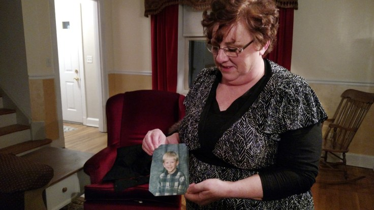 "Toni Hoy, at her home in Rantoul, Ill., holds a childhood photo of her son, Daniel, who is now 24. In a last-ditch effort to get Daniel treatment for his severe mental illness in 2007, the Hoys surrendered parental custody to the state. ""When I think of him, that"