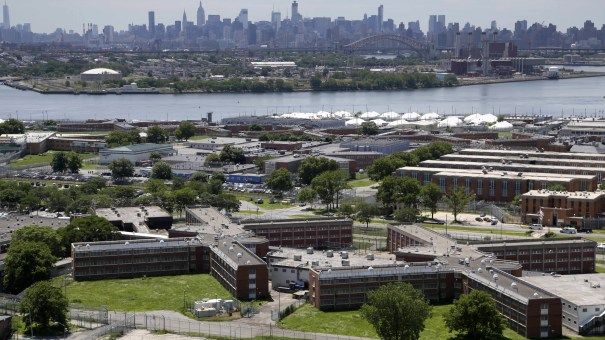 The Rikers Island jail complex in New York with the Manhattan skyline in the background. New York City lawmakers voted on Thursday to close the notorious jail complex.