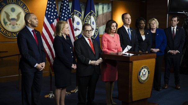 Rep. Jason Crow (far right) and other managers of the House impeachment case join Speaker Nancy Pelosi at a news conference at the Capitol.
