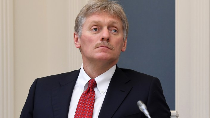 Kremlin spokesman Dmitry Peskov says he is currently hospitalized with COVID-19 — a revelation that came as Russia hopes to emerge from a shutdown despite a spike in new cases. Peskov is seen here during a video conference with Russian President Vladimir Putin in Moscow on April 14.