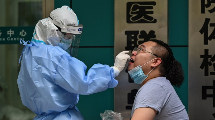 A man gets tested for the coronavirus Wednesday in Wuhan, China, the cradle of the global pandemic. Chinese authorities plan to test the city