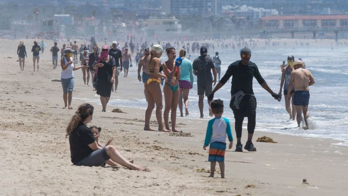 Californians enjoy the Manhattan and Hermosa beaches on the first day Los Angeles County allowed beaches to reopen after a six-week closure implemented to stop the spread of the coronavirus.
