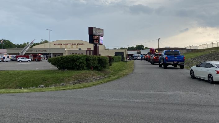 Seniors line up in cars with their families in the main drive of Webster County High School in Dixon, Ky., waiting to pick up their diplomas outside of the school one at a time. Like almost all schools across the U.S., county high school officials had to adapt this year