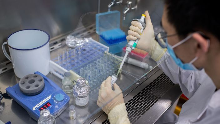 An engineer works in April on an experimental COVID-19 vaccine at the Sinovac Biotech facilities in Beijing. Sinovac Biotech is conducting one of four clinical trials that have been authorized in China.