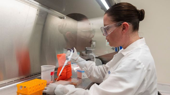 Dr. Rhonda Flores looks at protein samples on March 20 at Novavax labs in Gaithersburg, Md., one of the labs developing a vaccine for the coronavirus.