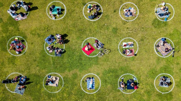 An aerial view shows people gathered inside painted circles on the grass encouraging social distancing at Dolores Park in San Francisco on May 22.