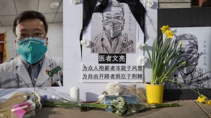A memorial for Li Wenliang, who called attention to the coronavirus in Wuhan, China, sits on UCLA