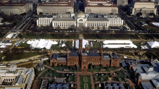 """An aerial view of the National Mall in Washington, D.C., with the Smithsonian Institution Building (""""The Castle"""") in the foreground and the Smithsonian"""