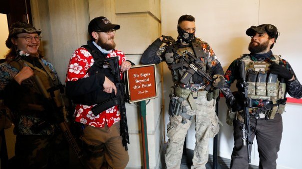 Armed protesters congregate at the Michigan state Capitol in Lansing on October 17, 2020. Monday, the Capitol Commission voted to ban open carry in common areas of the building.
