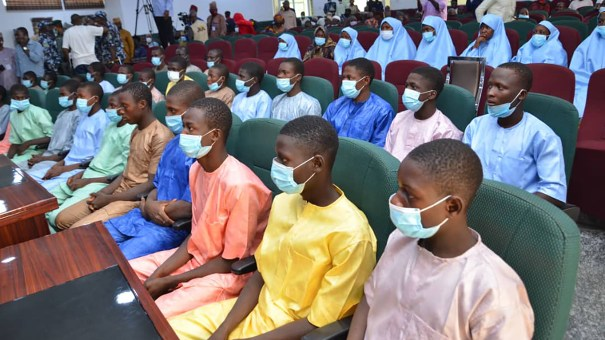 Abducted students of Government Science College Kagara sit in the state conference hall after being freed in Minna, Niger state, Nigeria, on Saturday.