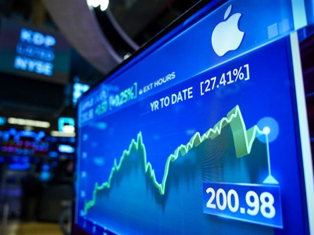 Stock numbers for Apple are displayed on a monitor on the floor of the New York Stock Exchange (NYSE) at the opening bell on August 13, 2019 in New York City.