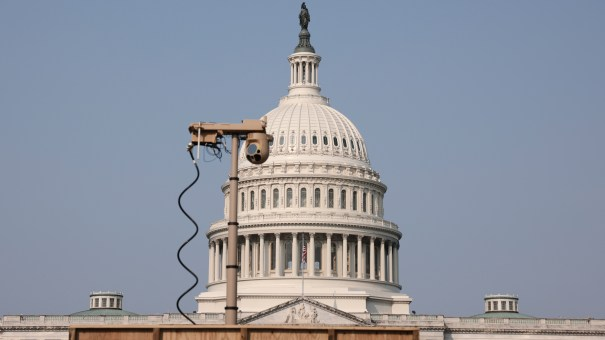 A recently installed surveillance camera is positioned near the U.S. Capitol on Monday.