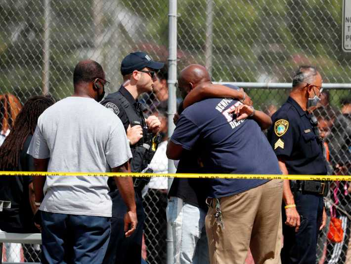 people seen outside hugging their loved ones as Newport police rescue students from the school.