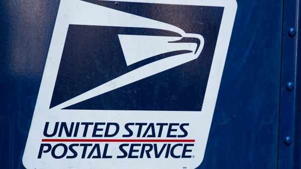 A USPS logo is seen on a mailbox in New York City.