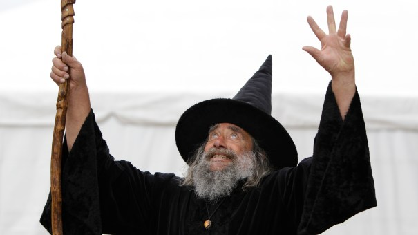 """The Wizard of New Zealand, also known as Ian Brackenbury Channell, casts a """"spell"""" during a television interview in Christchurch, New Zealand, in March 2011. His contract with the city will end in December after more than two decades."""