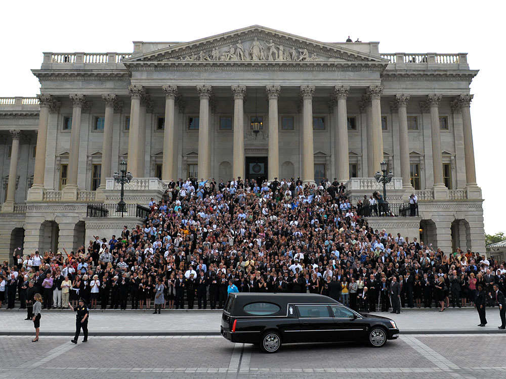 Mourners stand on the steps of the U.S. Capitol