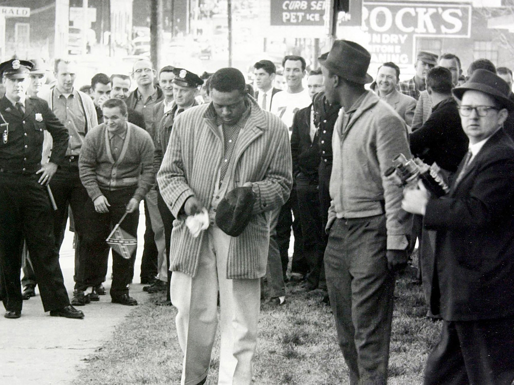 Bunt Gill wipes raw egg off his clothing during a civil rights protest in 1960 in Rock Hill, S.C.