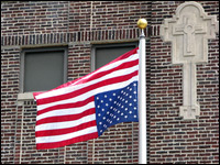 An upside-down flag flies outside of St. Sabina Catholic church and school on Chicago's South Side