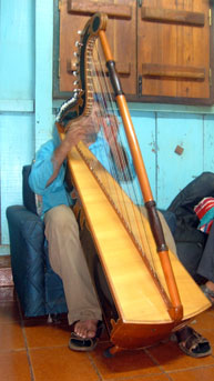 Don Benitez retires to his general store's back room in the evening to play his Paraguayan harp.