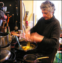 Niloufer Ichaporia King cooks Parsi eggs in one of her three kitchens.