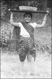 Niloufer Ichaporia King at age six, dressed as a Koli fisherwoman.