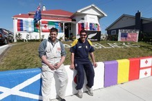 Ian Broderson and his son Shane spruced up their house and fence to the delight of passing rugby fans in Wanganui. Photo / Mark Mitchell