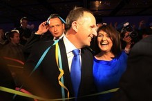 An elated John Key and his equally ecstatic wife, Bronagh, revel in the joy of the National Party's emphatic victory.<br /> Photo / Greg Bowker