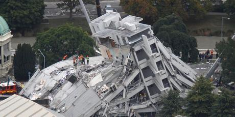 Rescue workers on the collapsed Pyne Gould Guiness Building in central Christchurch. Photo / Mark Mitchell
