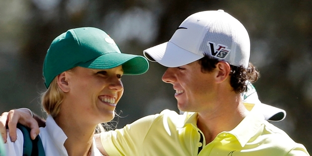 Caroline Wozniacki caddied for Rory McIlroy at a par three competition last year. Photo / AP