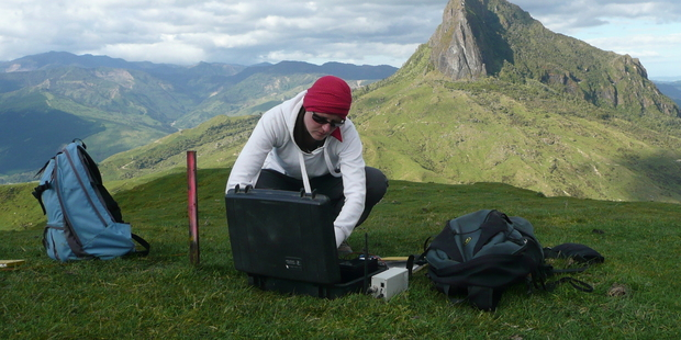 Caroline Little can be found going through earthquake data in the office or setting up seismic equipment, like here on Mt Hikurangi on the East Coast. Photo / GNS Science