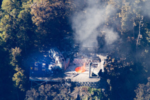 Flames leap from the ventilation shaft at the Pike River Mine in 2010. File photo / Mark Mitchell