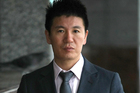 William Yan outside Auckland District Court in 2009. He has been accused of fraud by Chinese authorities. Photo /