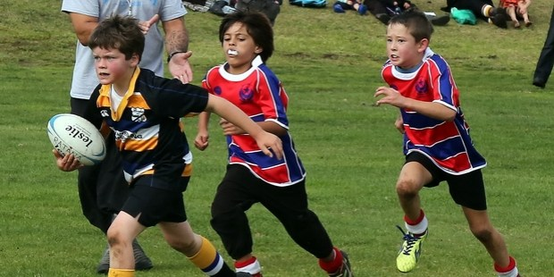 AND GONE: Border's Oliver Hooper sets his sights on the tryline, chased by Ratana players in their Under-8s game on the Springvale fields.PHOTO/030515WCSMKIDS5