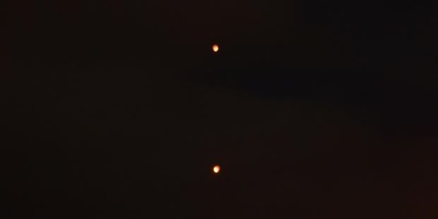 Tony Hutchins says these photos he took capture the strange lights over Tauranga. Photo / Supplied