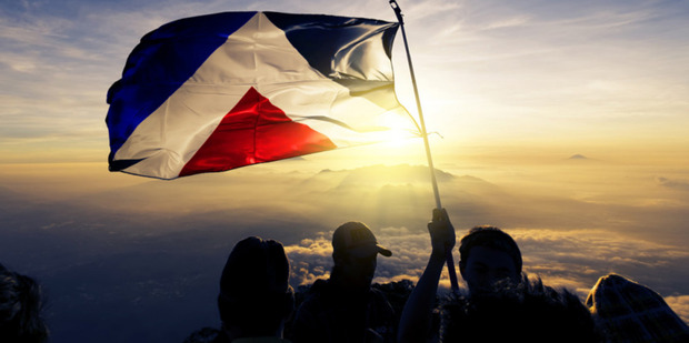 On aotearoaflag.tumblr.com, Aaron Dustin shows the Red Peak flag floating in the breeze at sunset.