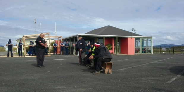Evicted protesters at Kaitaia Airport. Photo / Edward Rooney