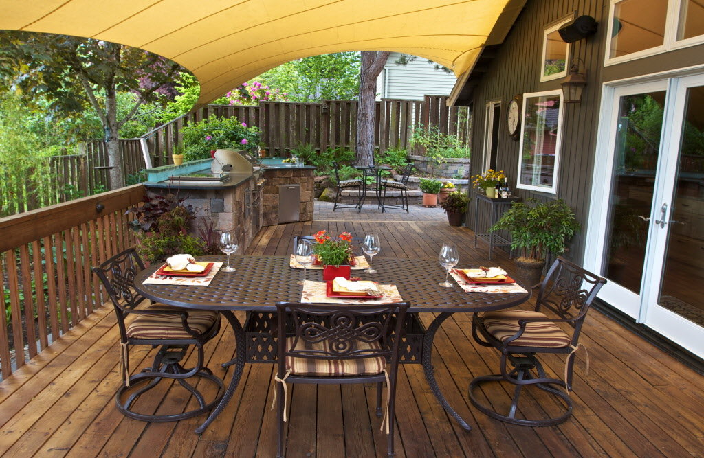backyard kitchens kitchen island with seating grow in popularity and sophistication oregonlive com
