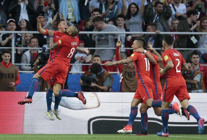 https://i0.wp.com/media.oregonlive.com/sports_impact/photo/soccer-confed-cup-chile-australia-263dc79fa02915ee.jpg?resize=694%2C471