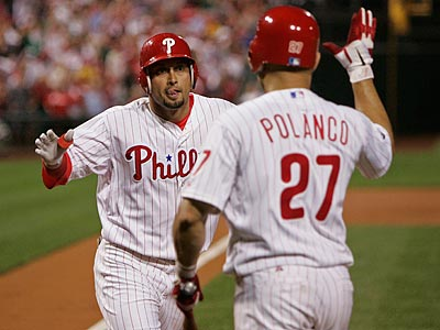 Shane Victorino is congratulated by Placido Polanco after giving the Phillies an early lead with a leadoff home run. (Michael Bryant/Staff Photographer)
