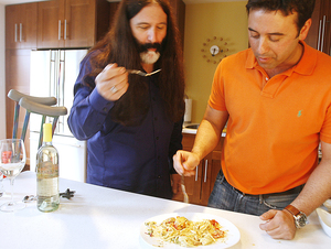 Robert (above left) and Ralph Pallarino sample a vegetarian dish; a bottle of Pierreno Grigio (left).