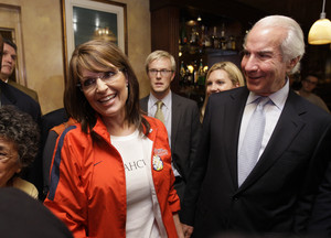 Associated Press--Alaska Gov. Sarah Palin, seen with Ed Snider (right), chairman of Comcast-Spectacor, visited the Irish Pub, on 20th and Walnut streets, last night before the start of the presidential debate.