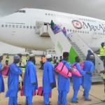 Hajj Pilgrims Boarding a plane