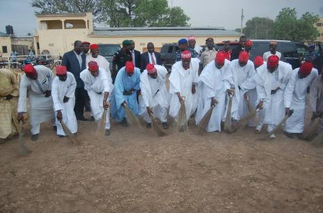 Governor Rabiu Kwankwaso sweeping the venue used for the PDP rally in Kano