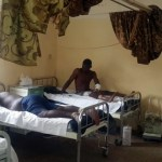 Onyebuchi Chigozie and other victims of the Nyanya bomb blast recieving treatment at the Nyanya general hospital