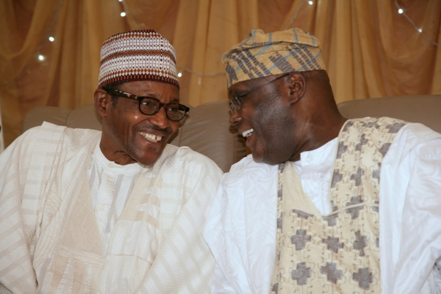 FILE PHOTO - 2019 presidential candidate of the PDP, Atiku Abubakar with President Muhammadu Buhari