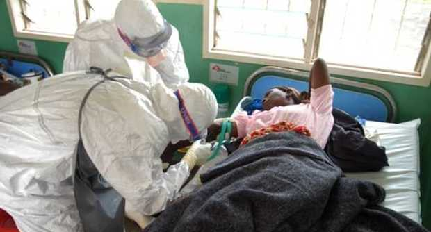 An Ebola patient being attended to
