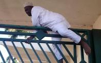 Hon Cheche, from Niger State, climbing over NASS gate to enter the premises after the police mounted a blockade targeted at the Speaker.