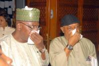 Senators Chris Ngige and Danjuma Goje choking on the teargas the police used on the Speaker.
